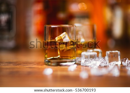 Whiskey drinks on  wood in bar #536700193
