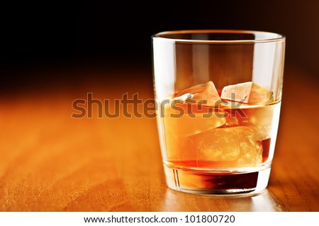 whiskey glass on wooden counter