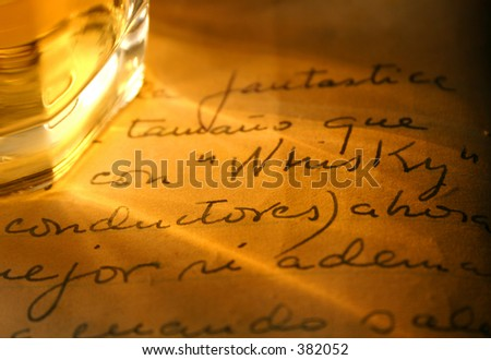 Whiskey glass with shadow and whisky written in old diary