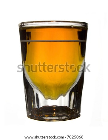 Whiskey in a crystal shot glass isolated on white.
