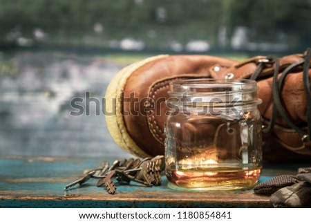 Whiskey in a Mason Jar, leather hunting boots and keys with room for copy