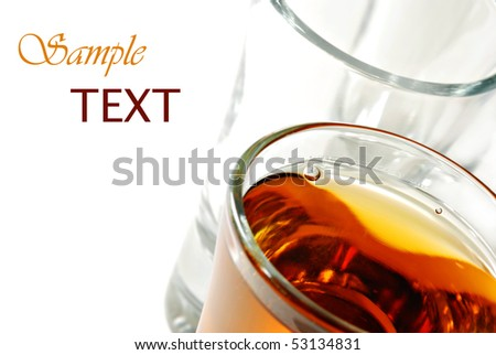 Whiskey in shot glass on white background with copy space.  Macro with shallow dof.