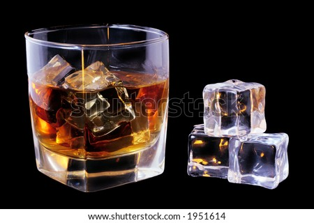 Whiskey in tumbler and ice cubes over black