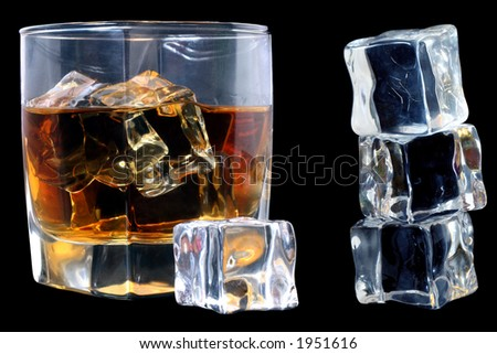 Whiskey in tumbler with ice cubes over black