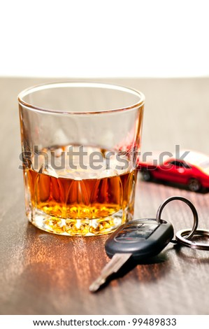Whiskey neat with a car key indicating don't drink and drive