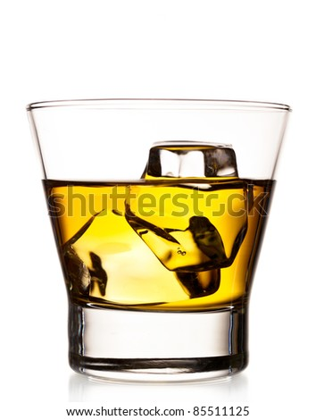 Whiskey on the rocks in an old fashion glass isolated on white