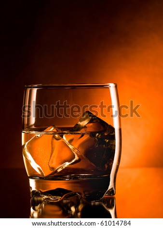 whiskey on the rocks, one glass - stock photo