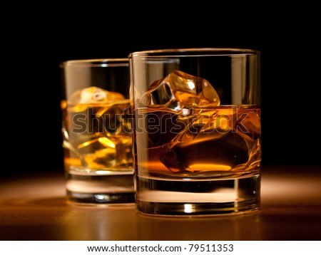 whiskey on the rocks, vibrant colors on black