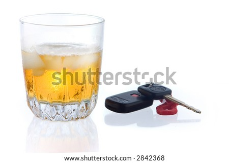 whiskey on the rocks with car key on white ground, with some reflection