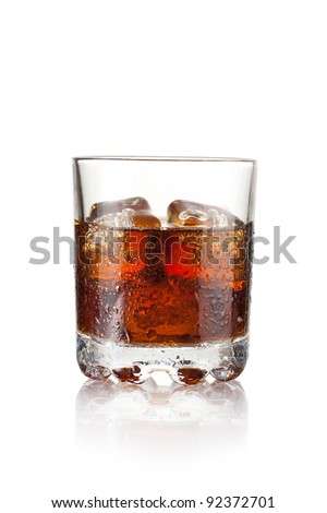 Whiskey with three cubes of ice on white background
