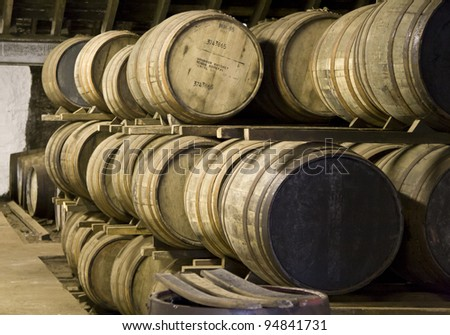 Whisky barrels maturing in a distillery in Scotland