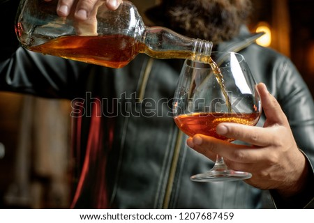 Whisky, brandy or cognac in glass. Alcohol addiction. Addictive group including alcohol cigarettes and drugs. Hard drugs and alcohol addict. Serious sad woman having alcohol addiction