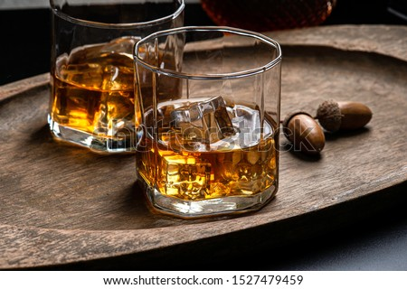 Whisky or bourbon with ice on the rock style in glass dark background . concept bar whisky .  ストックフォト ©
