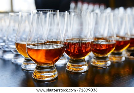 Whisky or cognac in snifters, soft focus, amber-blue toned