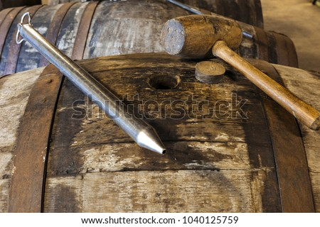 WHISKY THIEF or VALINCH. Used as a pipette by the master distiller to extract a sample of whisky from a barrel for sampling or quality control. It is inserted into the barrel through the bunghole #1040125759