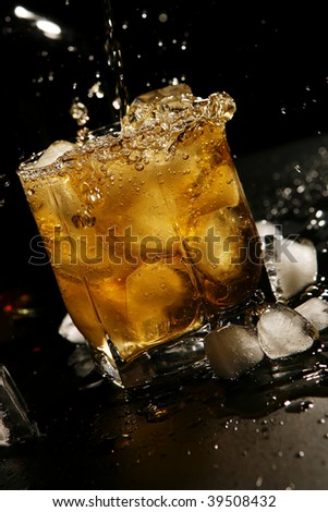 whisky with ice on black background