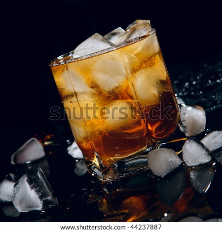 whisky with ice on black background - stock photo