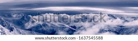 Whistler, British Columbia, Canada. Beautiful Panoramic View of the Canadian Snow Covered Mountain Landscape during a cloudy and vibrant winter sunset. Black and White Art Zdjęcia stock ©