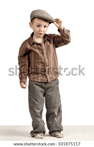 Whistles at you all, but I say hello. Regards, rogue.A little boy greets holding cap in his hand.