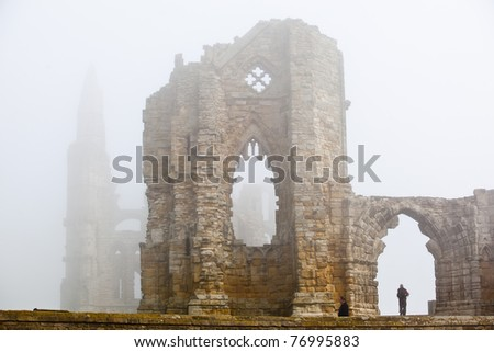 Whitby Abbey castle shrouded in fog a ruined Benedictine abbey sited on Whitby's East Cliff in North Yorkshire on the north-east coast of England.UK - stock photo