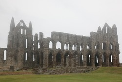 Whitby Abbey taken in fog, ruined Benedictine abbey sited on Whitby's East Cliff in Yorkshire, England, UK