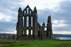 Whitby on the North Yorkshire coast, England. The ruins of Whitby Abbey on the East Cliff home of Caedmon, the earliest recognised English poet, lived.