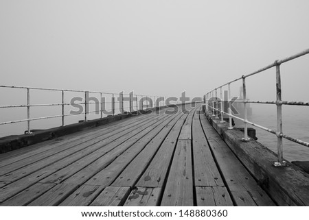 Whitby pier with fog in the background