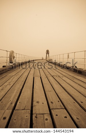 Whitby west pier on a foggy day