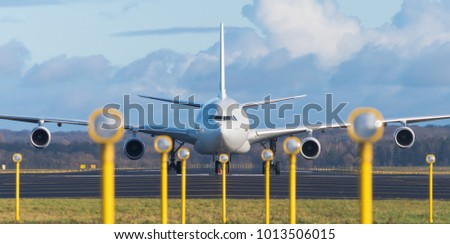 white airbus A340-300 at the end of the runway Stock photo ©