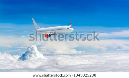 White airplane flying above cloud #1043025238