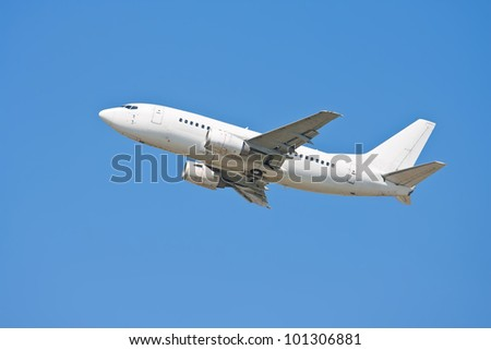 White Airplane in the blue sky - big passenger airliner taking off