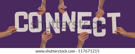 White alphabet lettering spelling CONNECT held up over a purple studio background by outstreched female hands