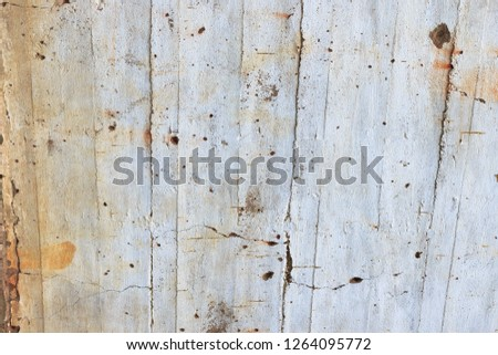 White ancient wall painted with texture, cracks and lines from construction. Concrete wall fragment built in 1935, Latvia.