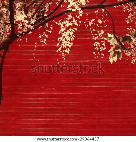 white and black blossom on red wooden slatted background - stock photo