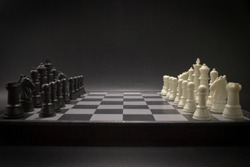 White and black chess battle on chess board.