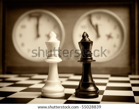 White and black king on the chessboard opposing each other,old chess clock in the background,sepia toned,can be used as concept for conflict,meeting,agreement..