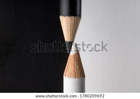 White and black pencils. Contrast and opposite concept Stockfoto ©