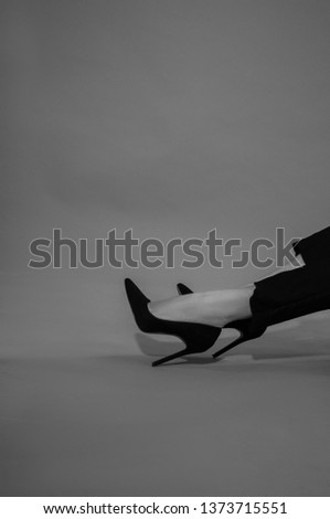 White and black photo and women's legs