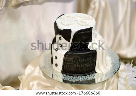 White and black tuxedo wedding cake