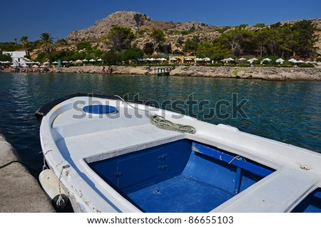 White and blue boat in Kalithea Thermes Bay, Rhodes island - stock photo