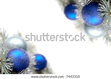 White and blue bulbs covered with snow and spruce twigs