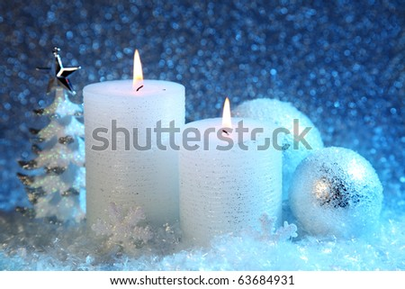 White and blue christmas decoration on snow background