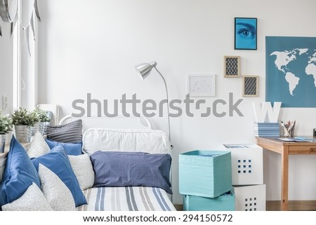White and blue designed teen boy bedroom #294150572