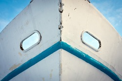 White and blue metal fishing boat nose