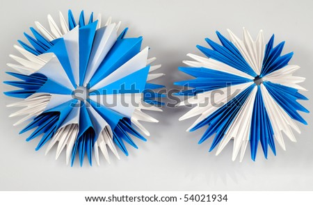 White and blue origami virus or snowflake or flower