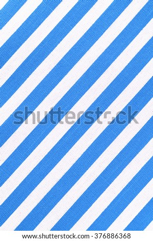 white and blue striped fabric texture. #376886368