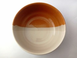 White and brown ceramic bowl isolated on white background. two colors bowl