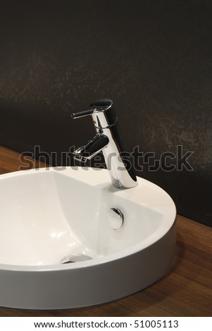 White and clean washbasin and chrome tap