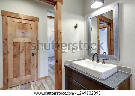 White and fresh bathroom interior with a rectangular vessel sink and dark gray countertop. #1249102093