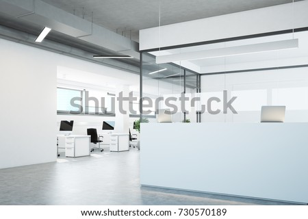 White and glass reception counter standing in an open office environment with white walls, a concrete floor and rows of computer tables. Side view. 3d rendering mock up #730570189